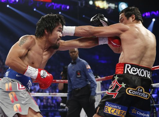 Manny Pacquiao and Juan Manuel Marquez in the ring on Dec. 8, 2012 at the MGM Grand, Las Vegas.